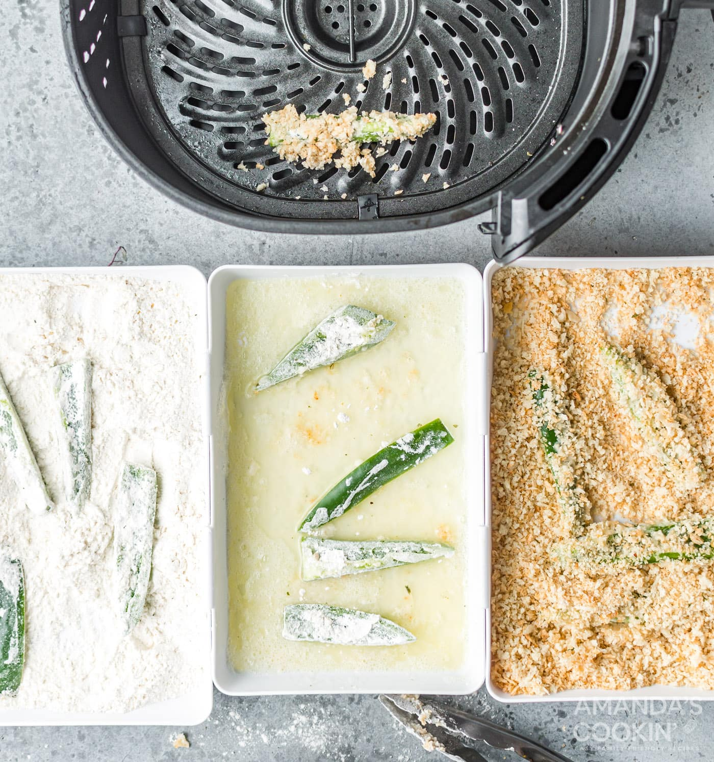 jalapeno slices in dredging stations of buttermilk, panko, and flour