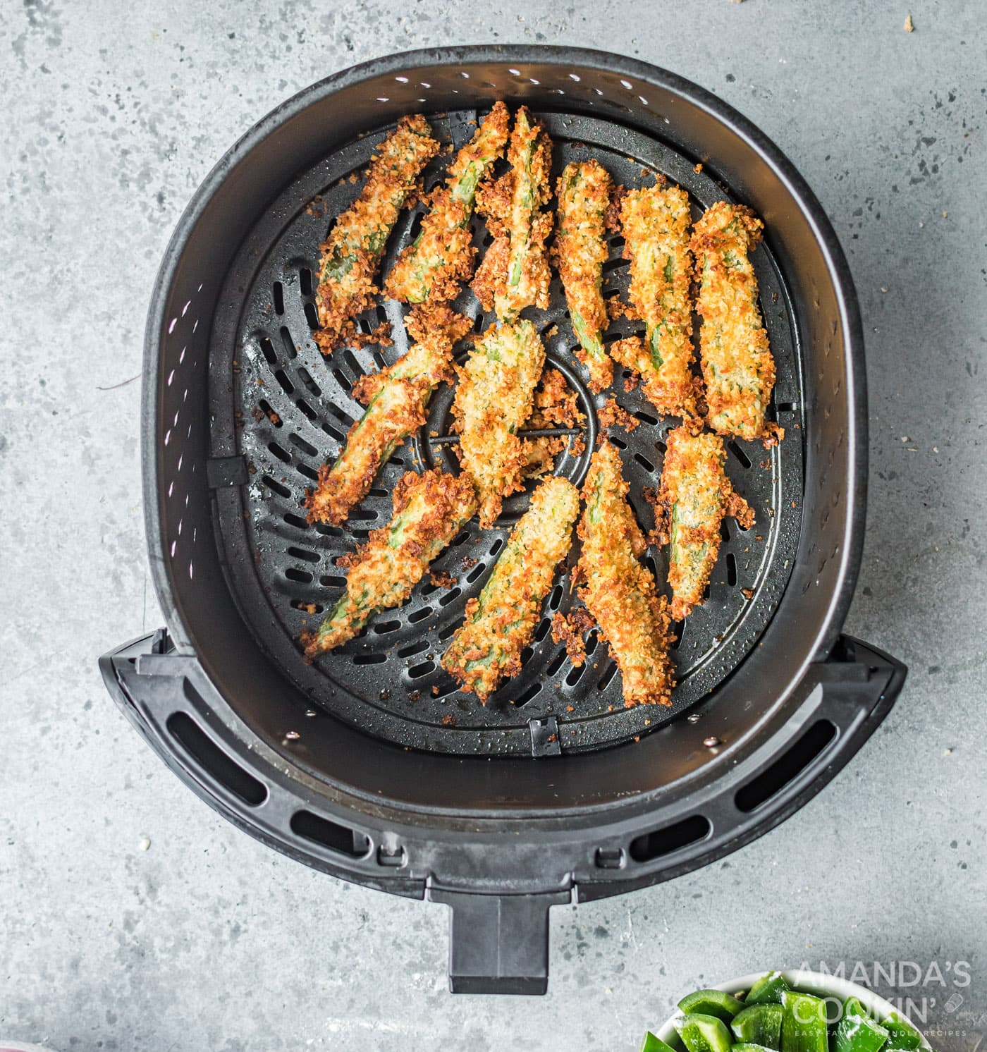 golden brown cooked jalapeno fries in the air fryer