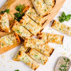 sliced garlic bread on a cutting board