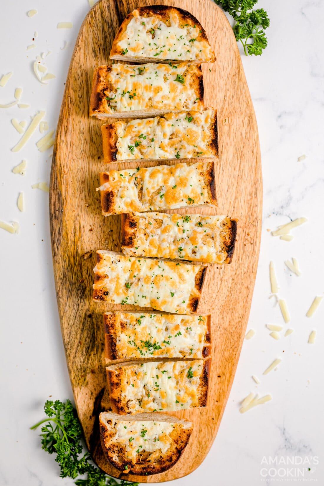 sliced Cheesy Garlic Bread on a cutting board