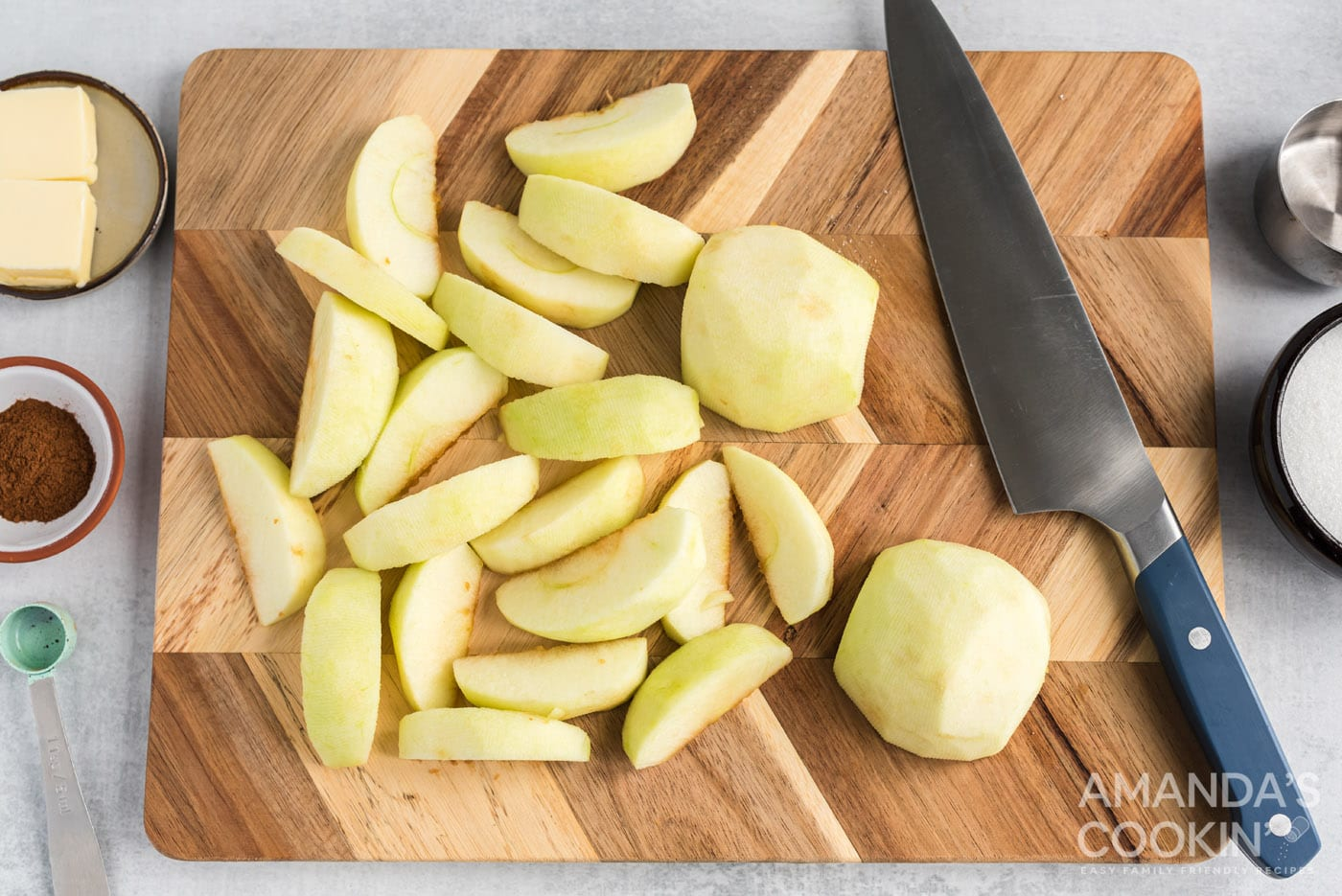 sliced granny smith apples on cutting board