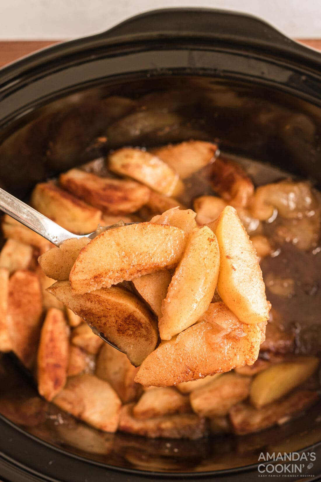 spooning out some Crockpot Cinnamon Apples