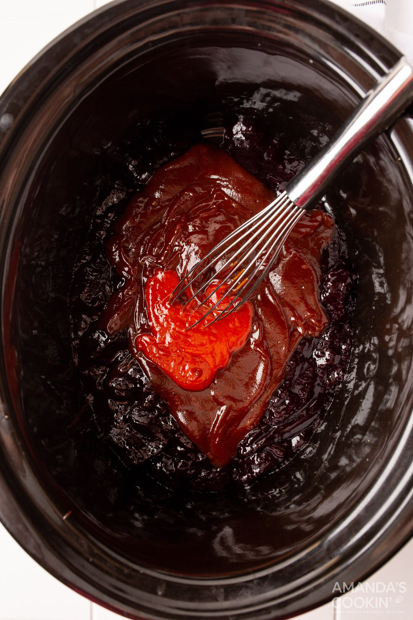 sweet and spicy meatball sauce in crockot
