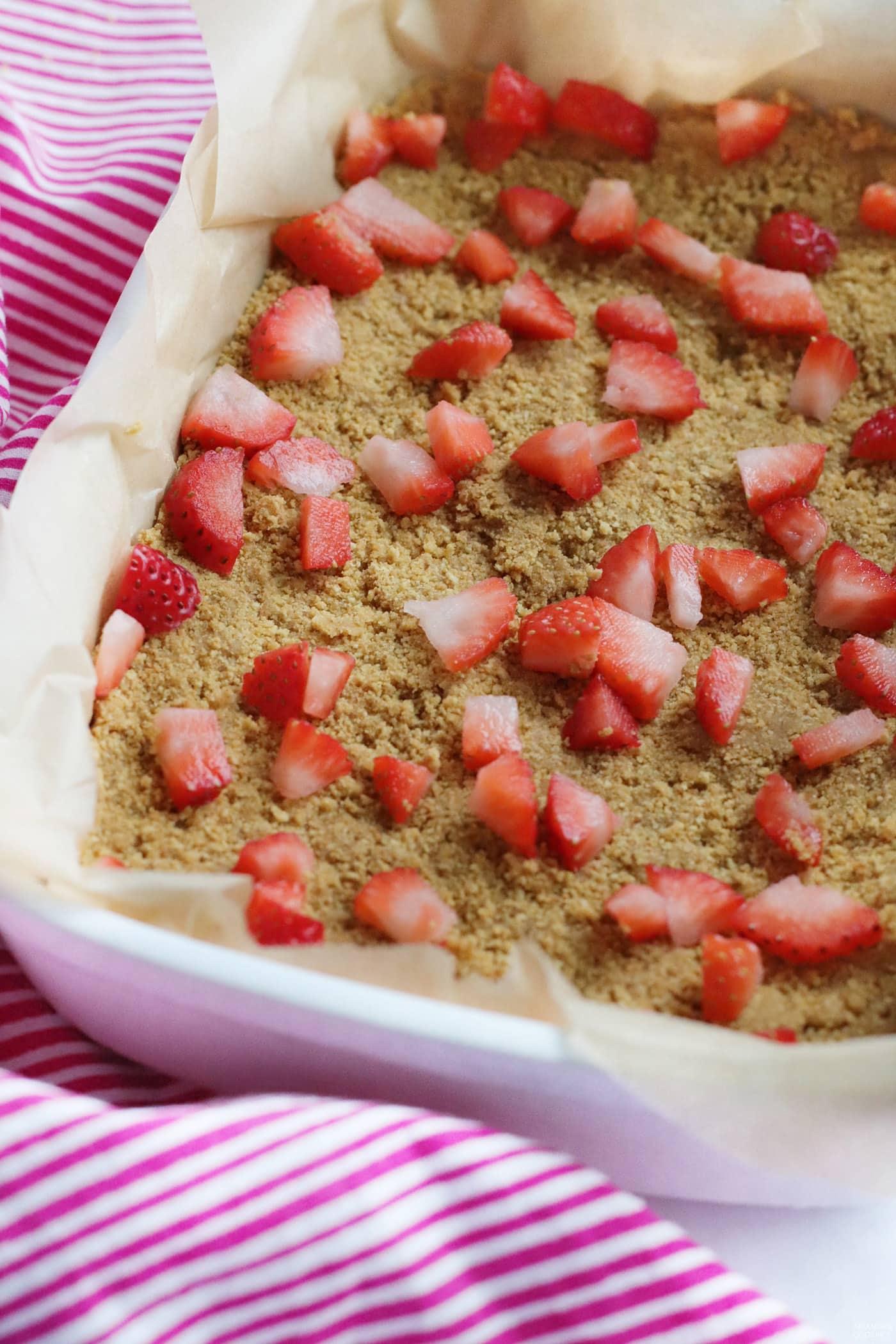 chopped strawberries on graham cracker crust
