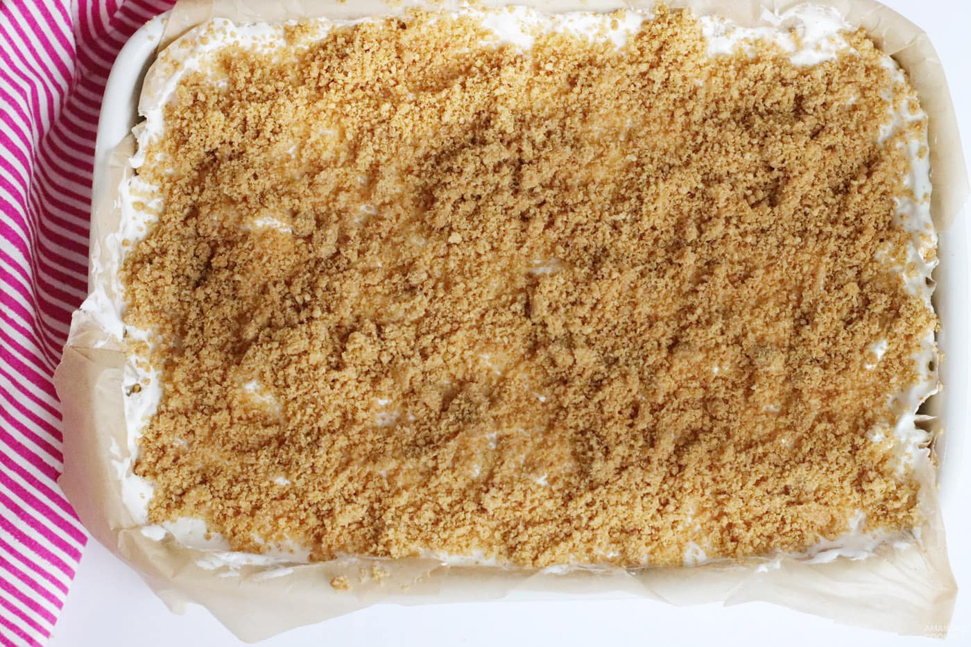 graham cracker topping on strawberry cheesecake bars