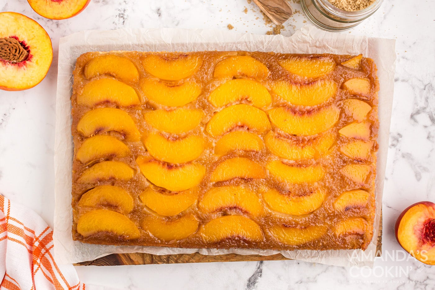 baked peach upside down cake in a glass dish