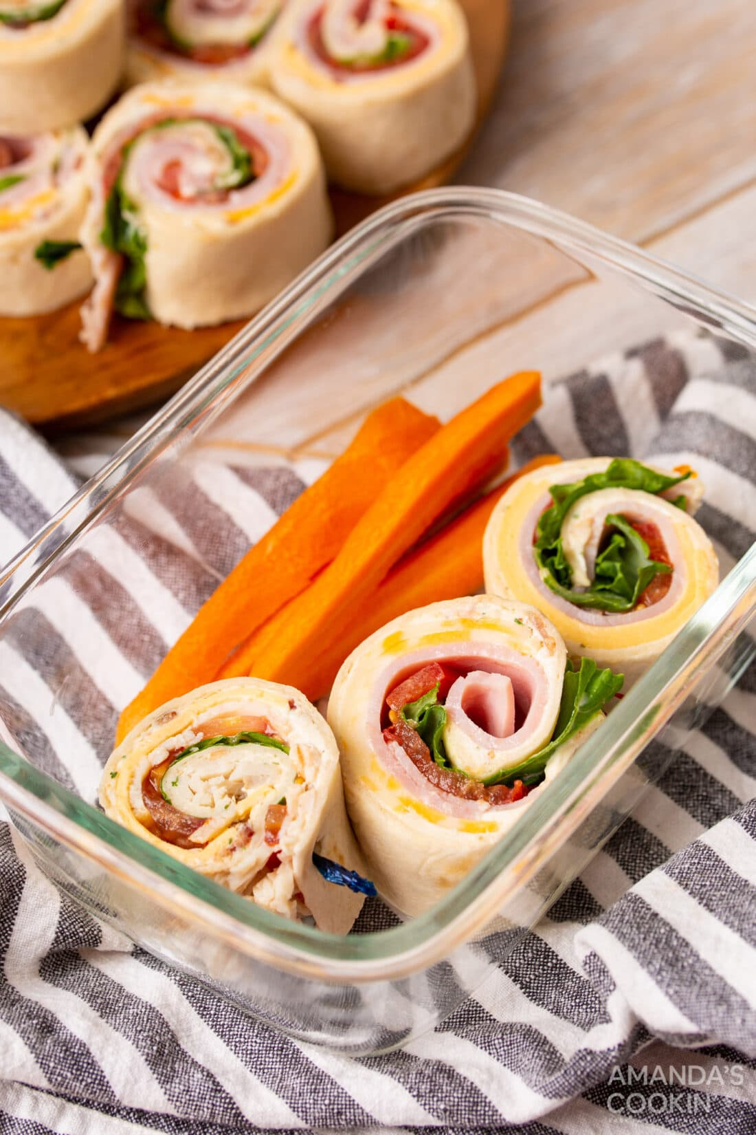 Pinwheel Sandwiches in a lunch container with carrots