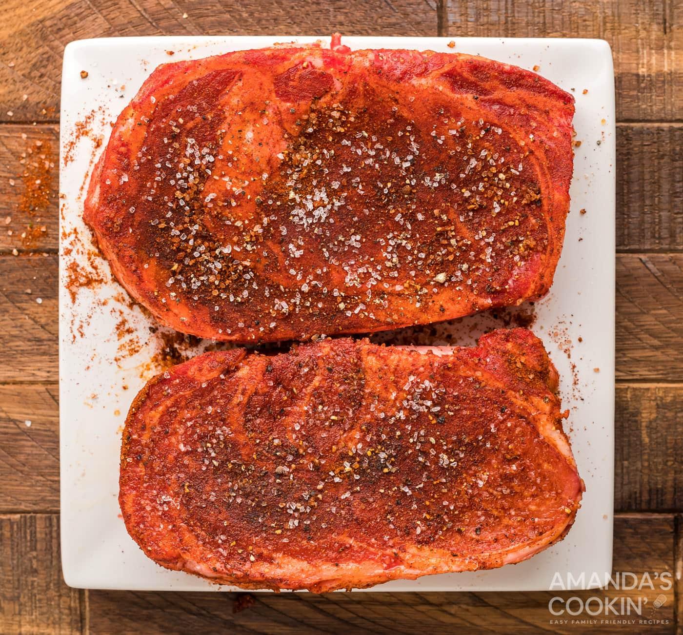 seasoned ribeye on cutting board