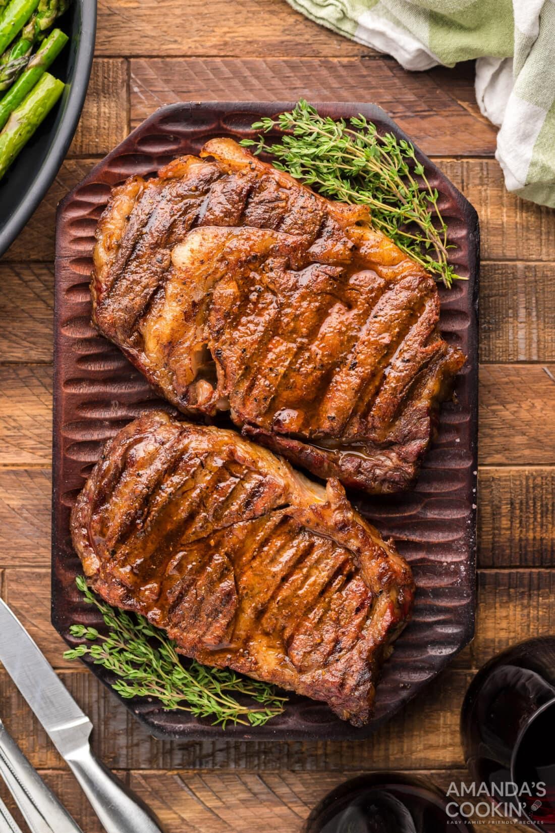 2 Smoked Ribeye steaks on cutting board