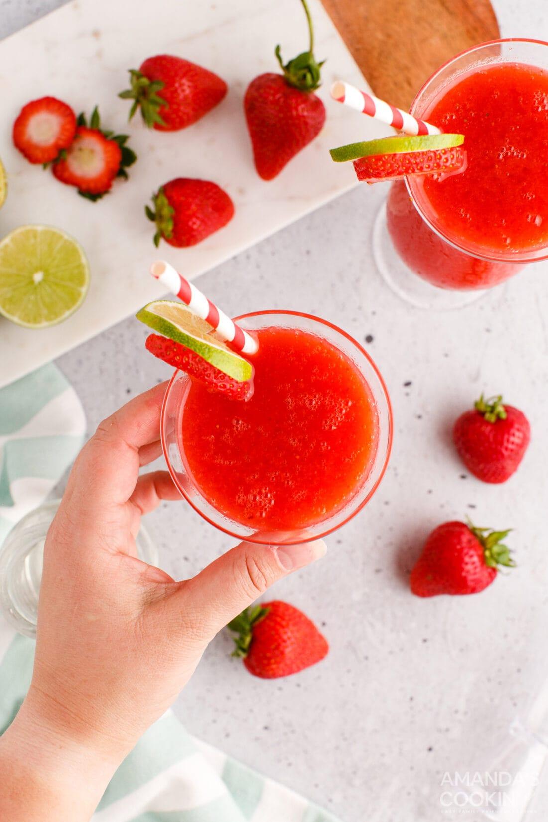 hand reaching for a Strawberry Daiquiri
