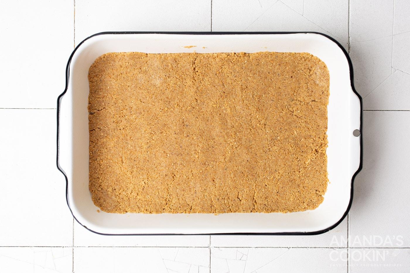 graham cracker crust in a baking pan