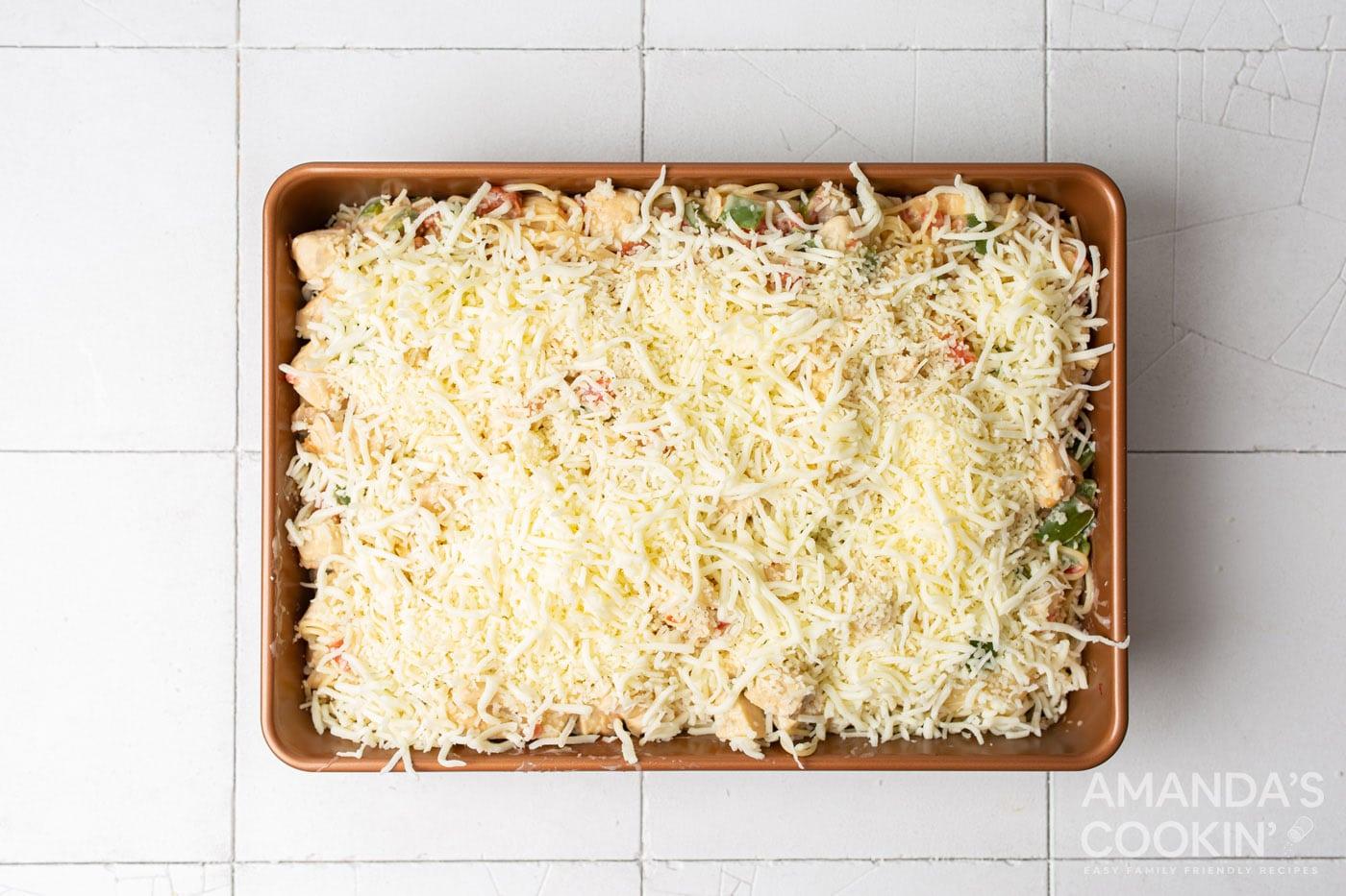 shredded cheese on top of chicken spaghetti casserole