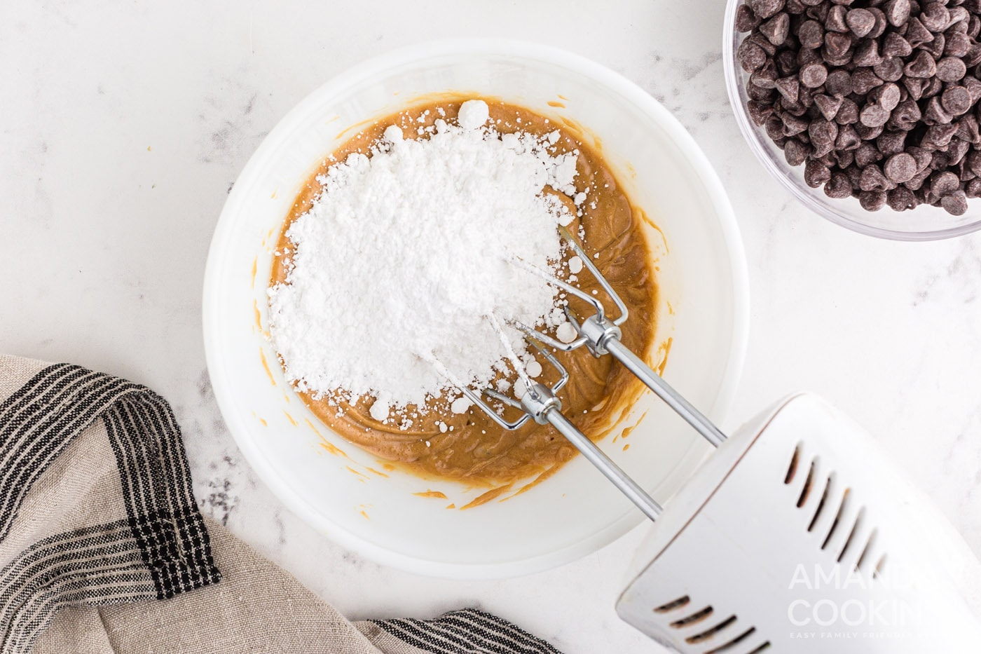 mixing powdered sugar into peanut butter mixture