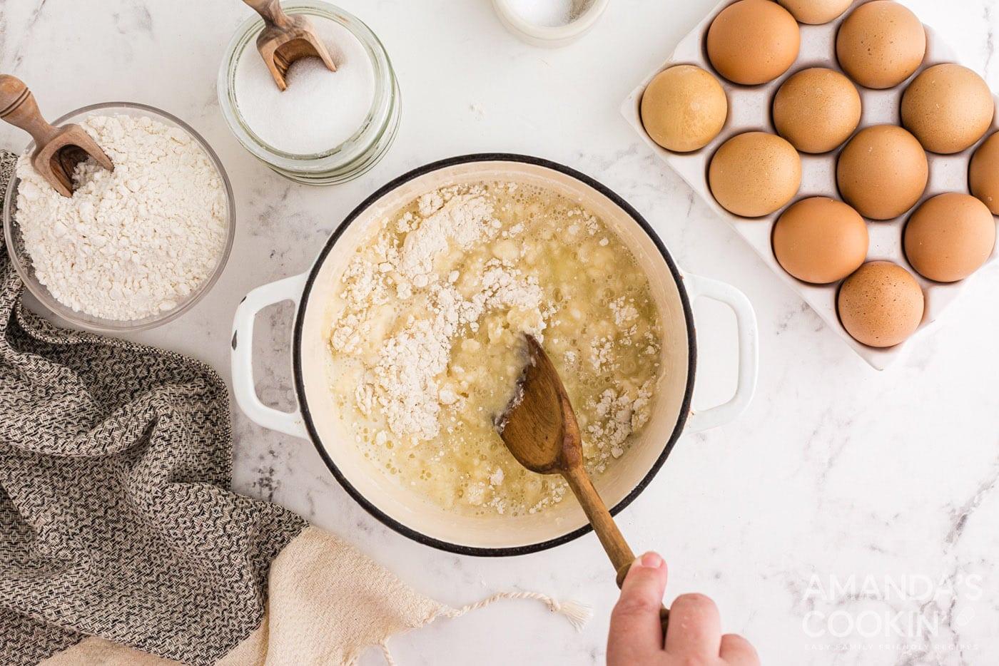 stirring flour into butter mixture in saucepan