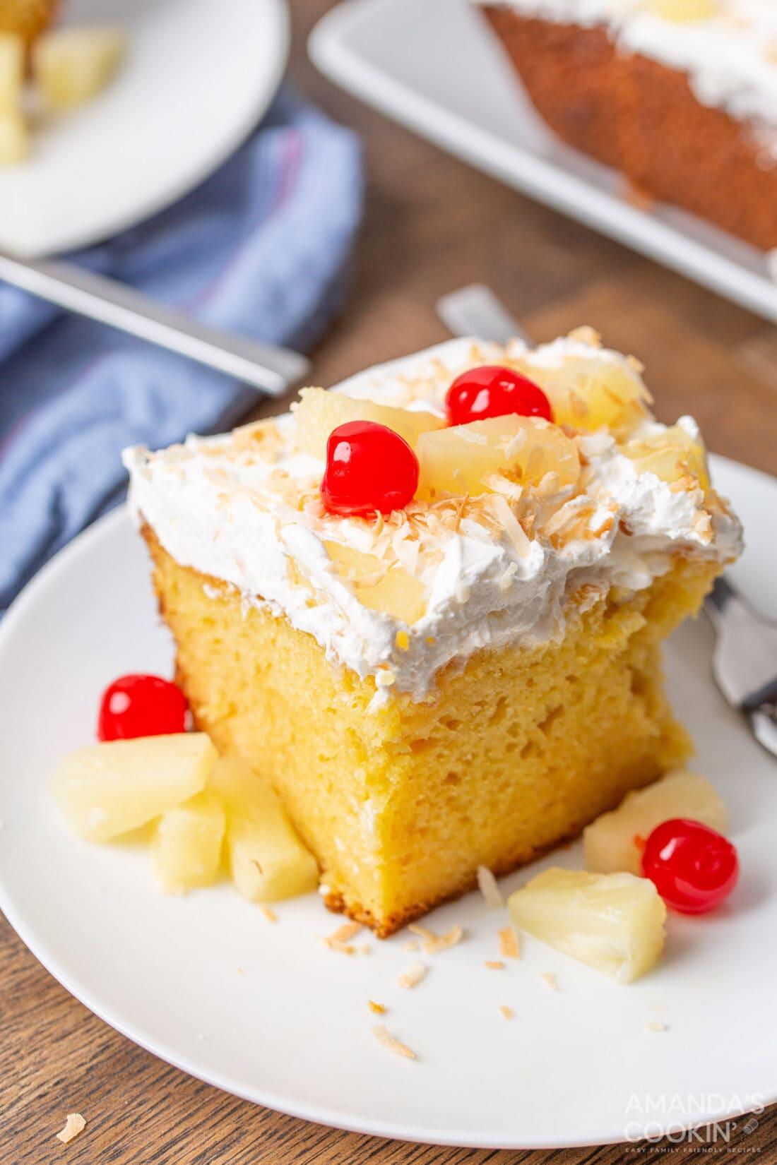 slice of pineapple poke cake