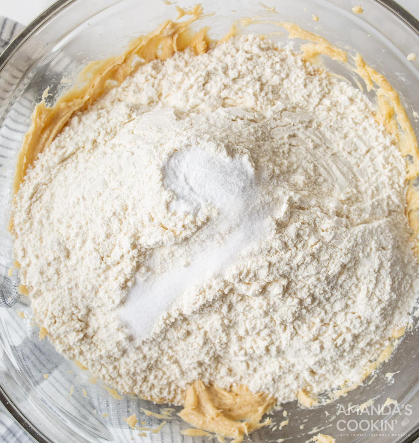 flour and baking powder on top of cookie dough