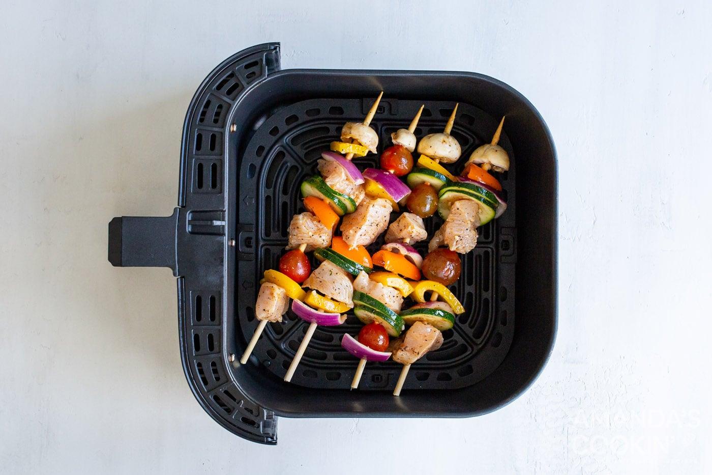chicken kabobs in an air fryer basket