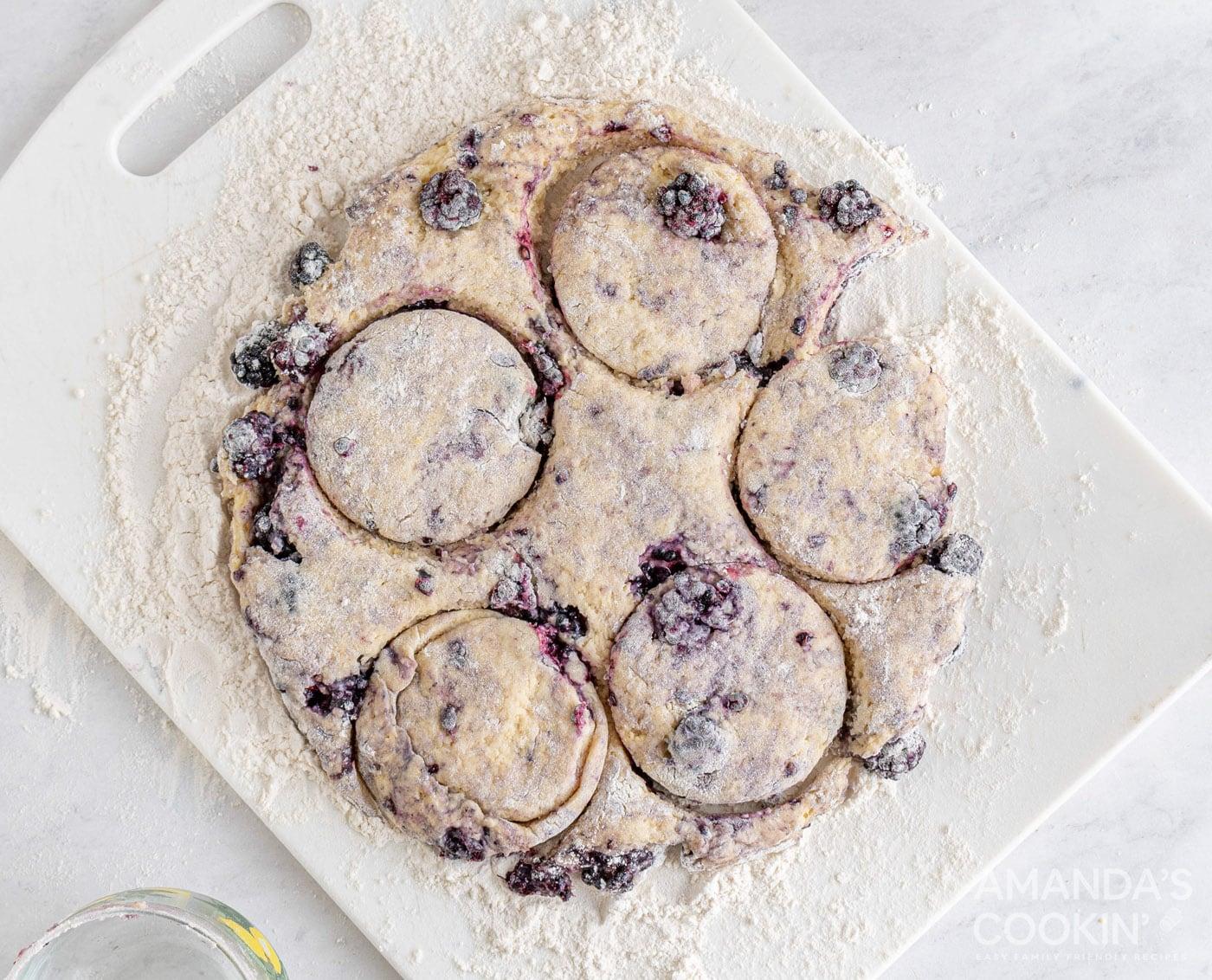 cutting out blackberry scone dough