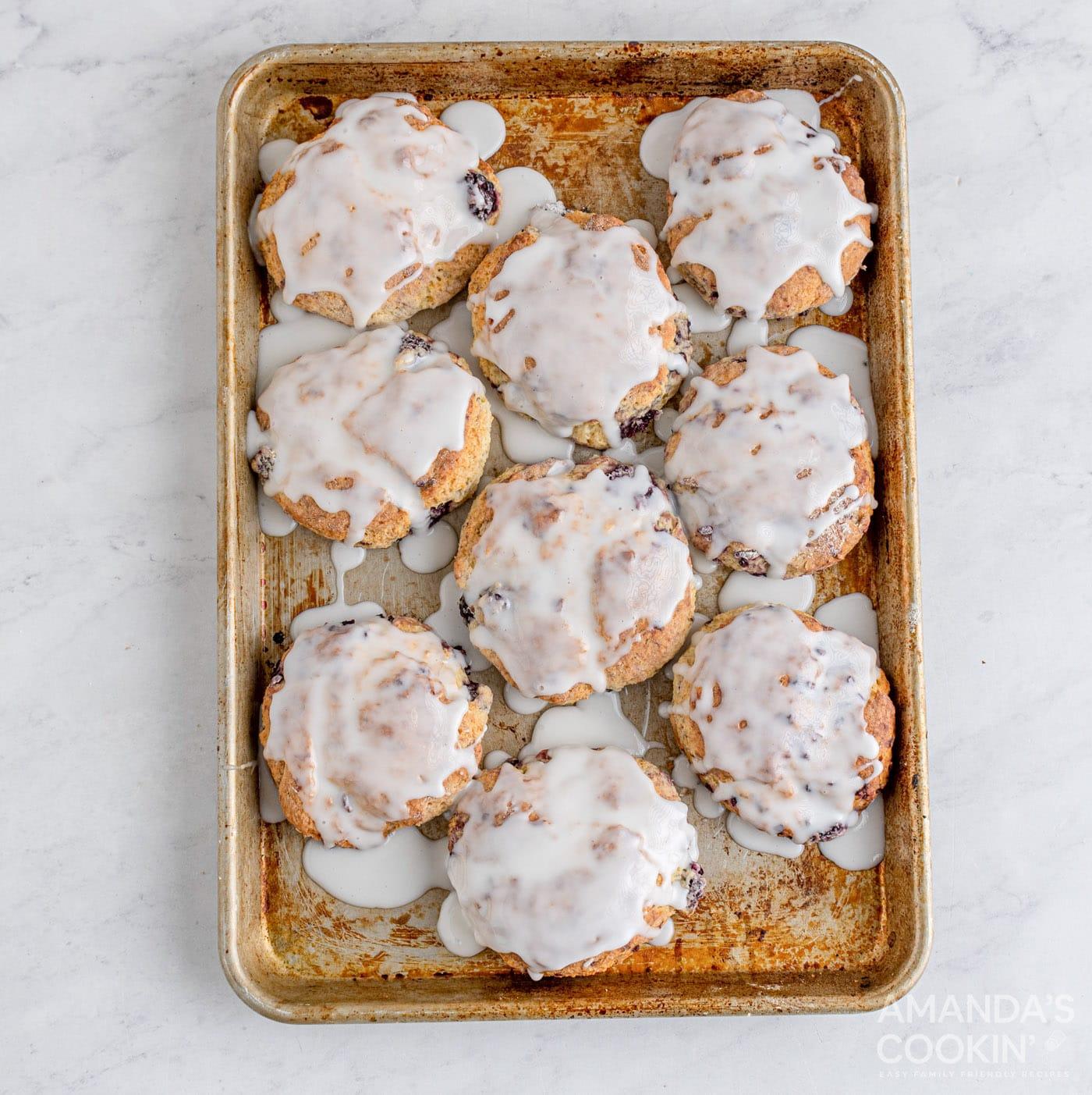glazed blackberry scones on baking sheet