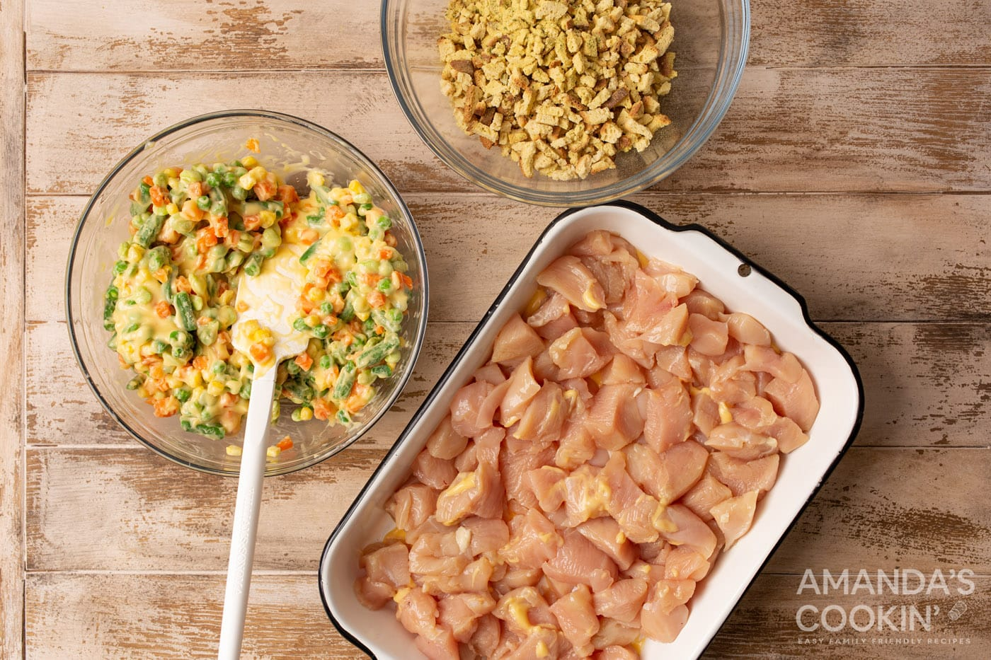 diced chicken in a casserole dish with veggies and stuffing