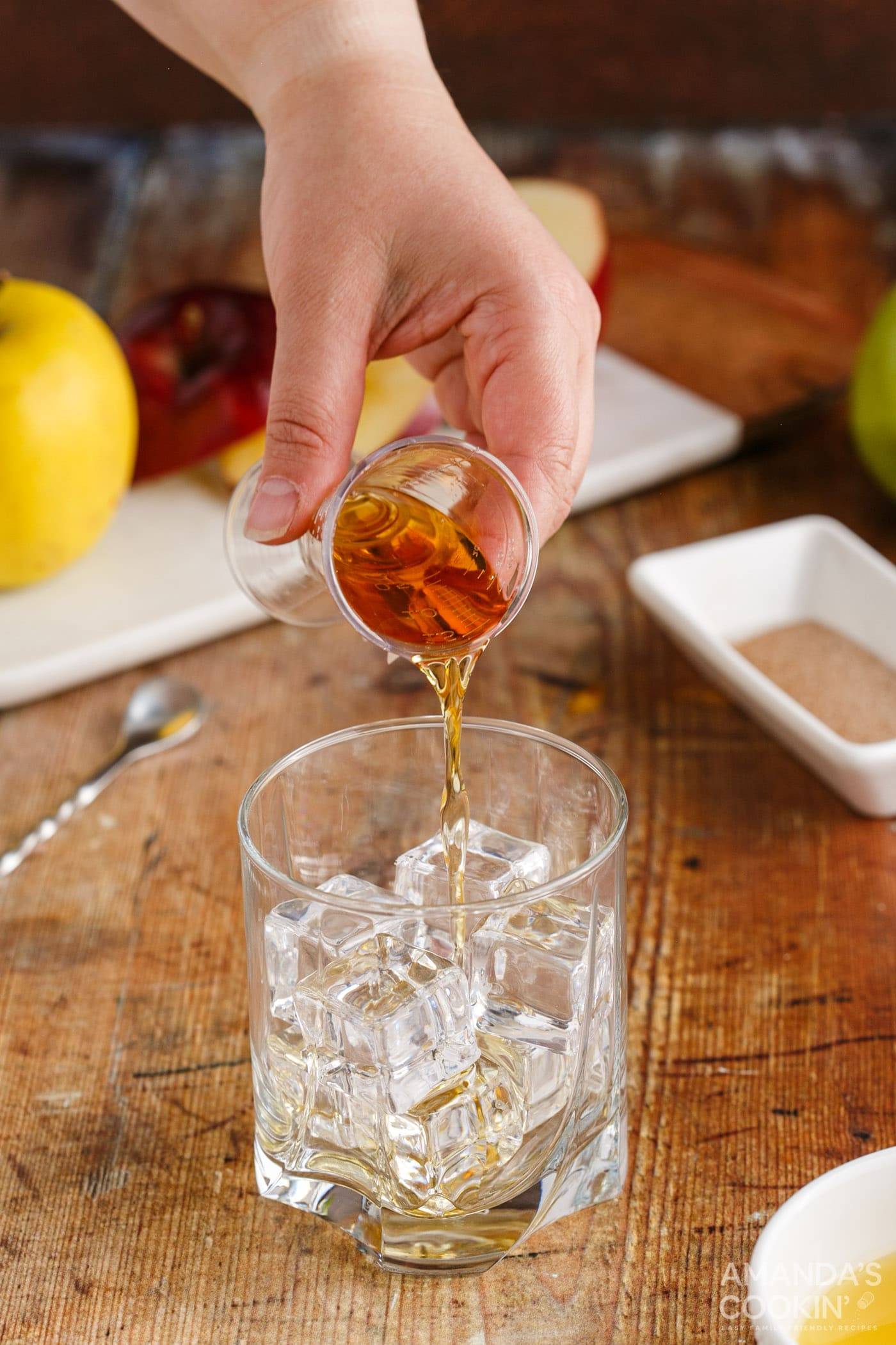 pouring fireball whiskey into a shot glass
