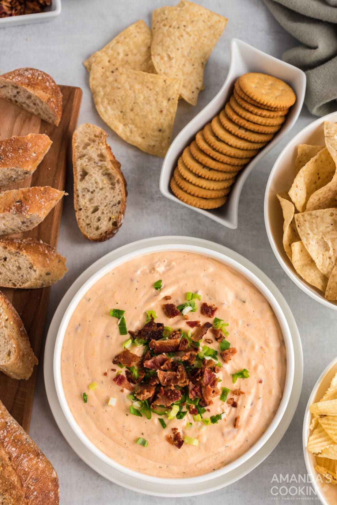 Crockpot Cheese Dip in a bowl surrounded by crackers
