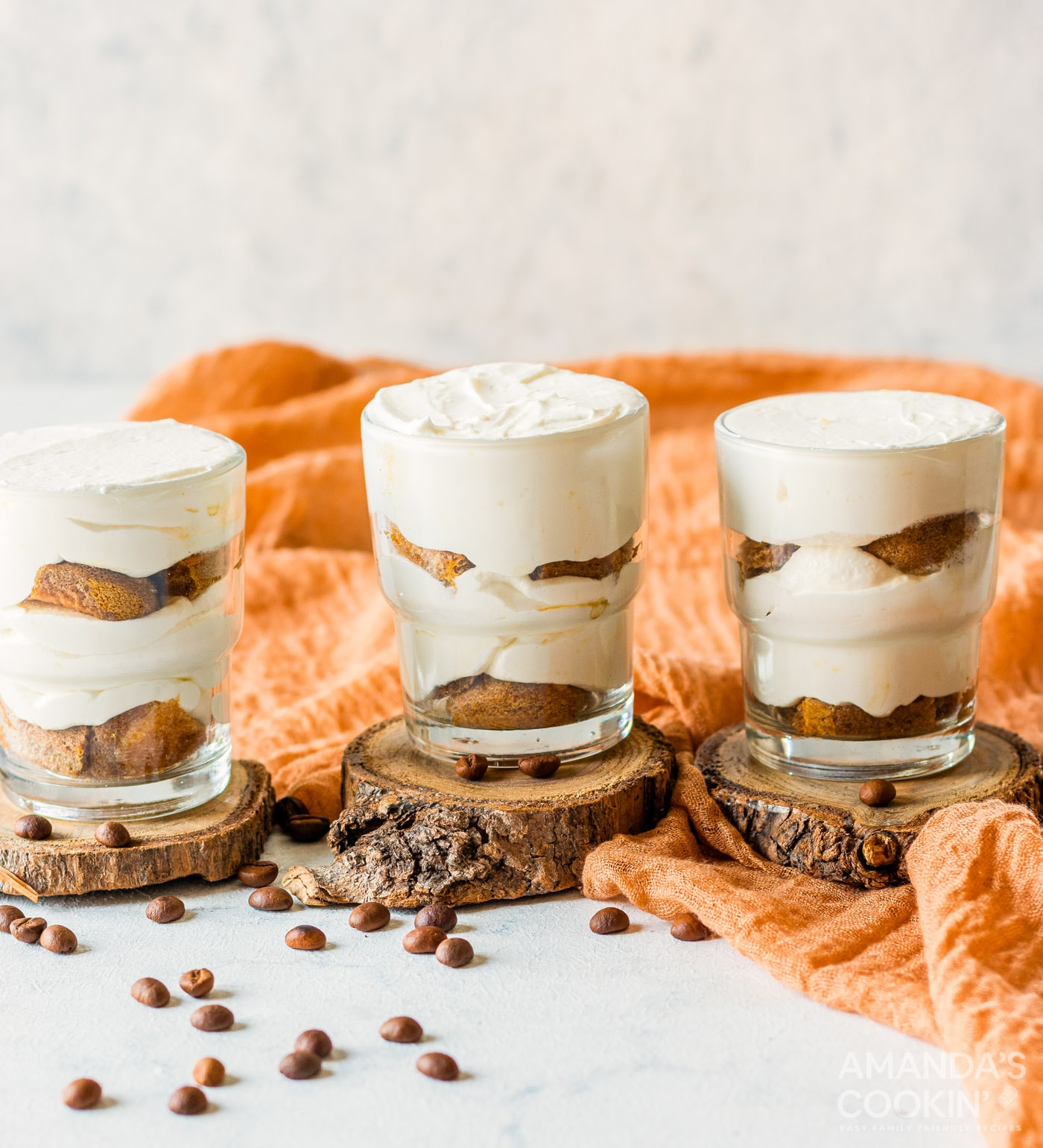 mascarpone cheese mixture with ladyfingers in a cup