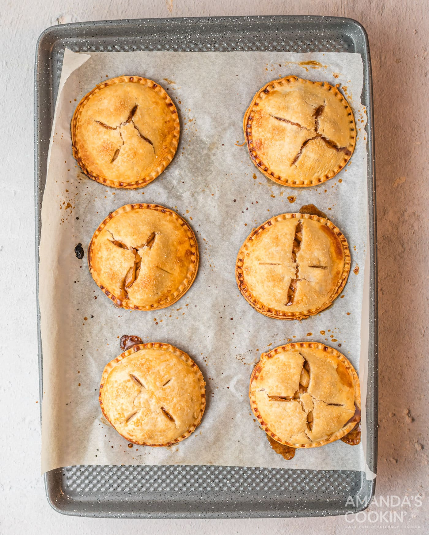 golden brown apple hand pies on baking sheet
