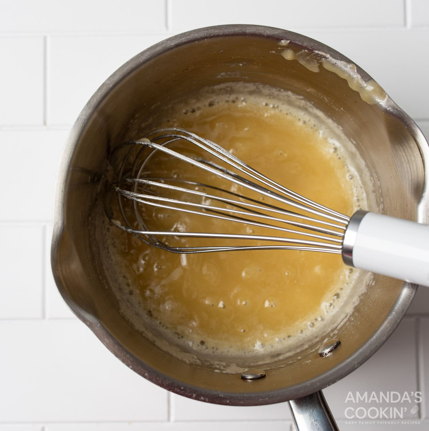 whisking butter and flour in a saucepan