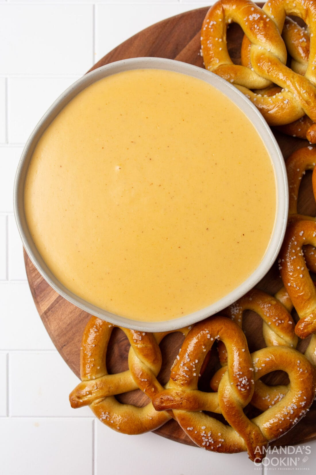 bowl of Beer Cheese Dip surrounded by pretzels