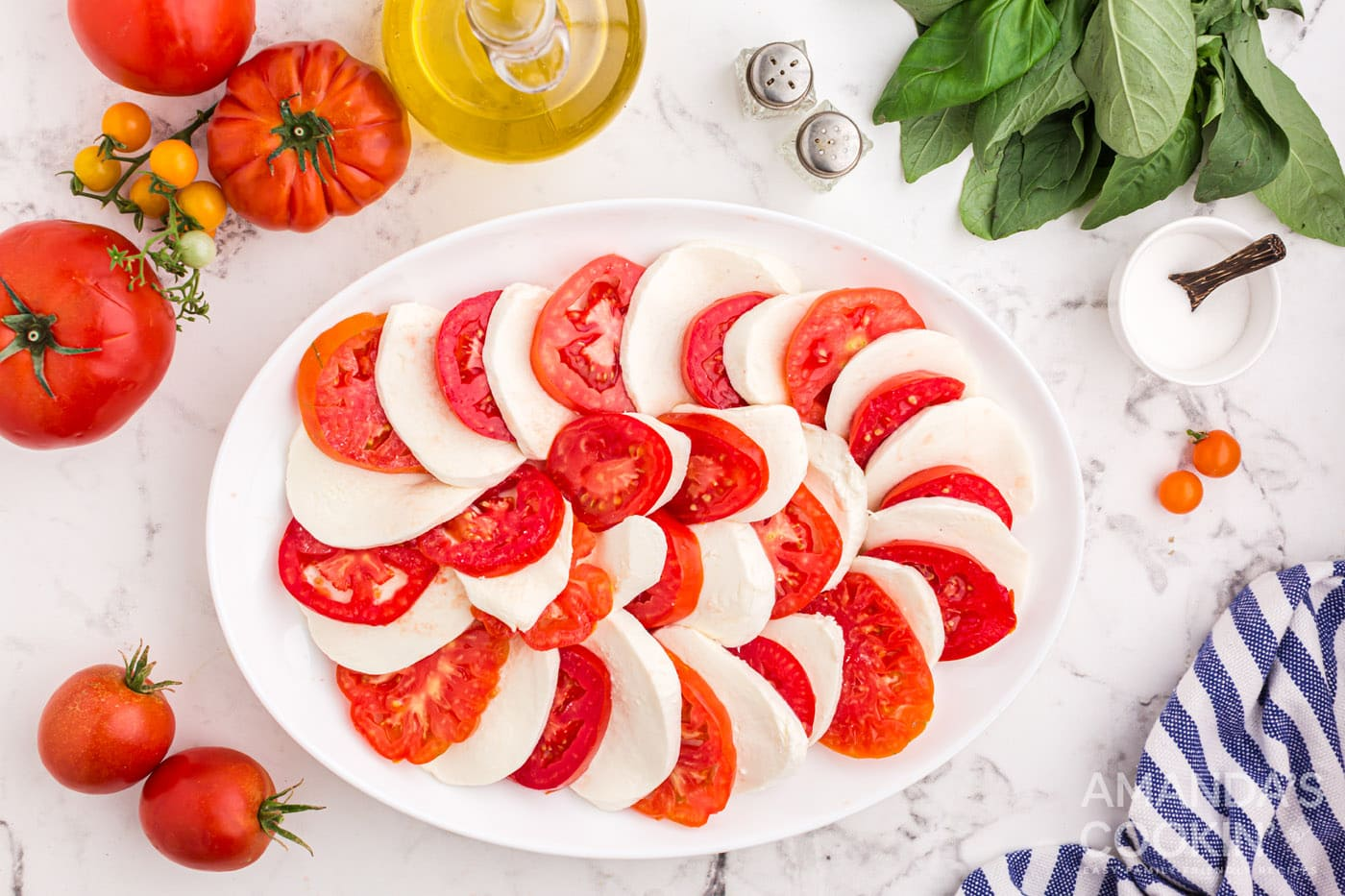 sliced tomatoes and mozzarella arranged on a plate