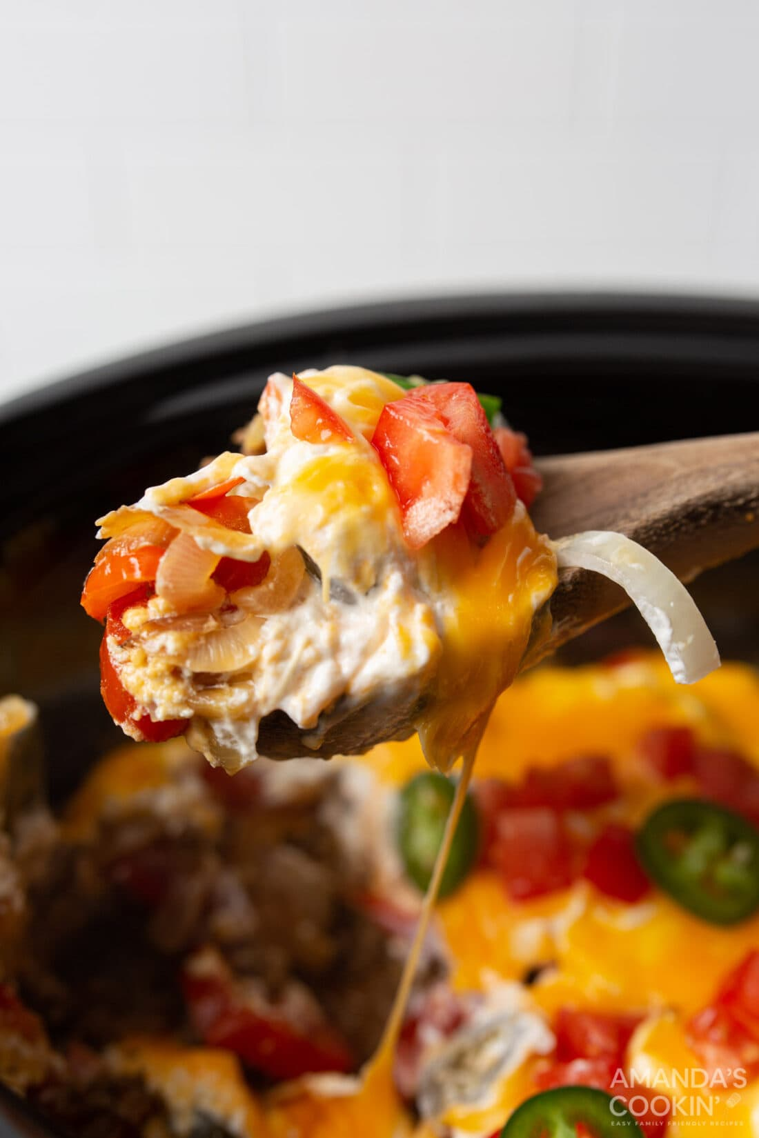 serving spoon of crockpot john wayne casserole
