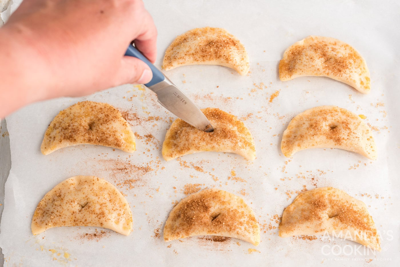 cutting a hole on top of pumpkin hand pies