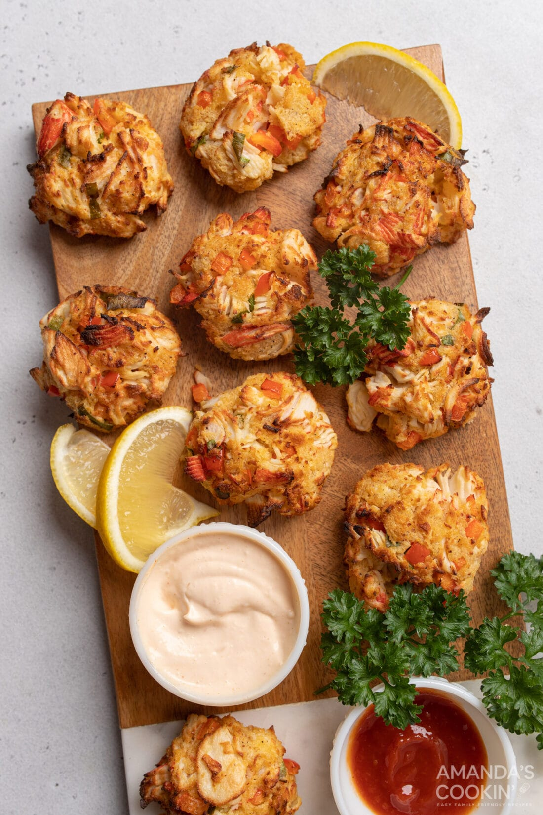 Air Fryer Crab Cakes ON A CUTTING BOARD