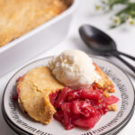 Cherry Pineapple Dump Cake on a plate with ice cream