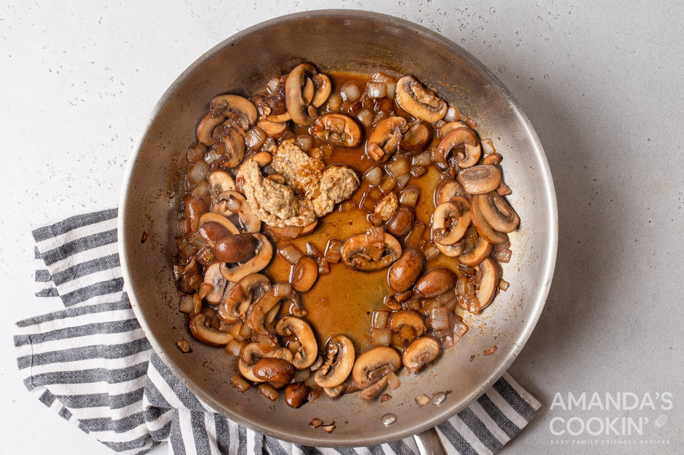 white wine with mushrooms and onions sauteed on a skillet