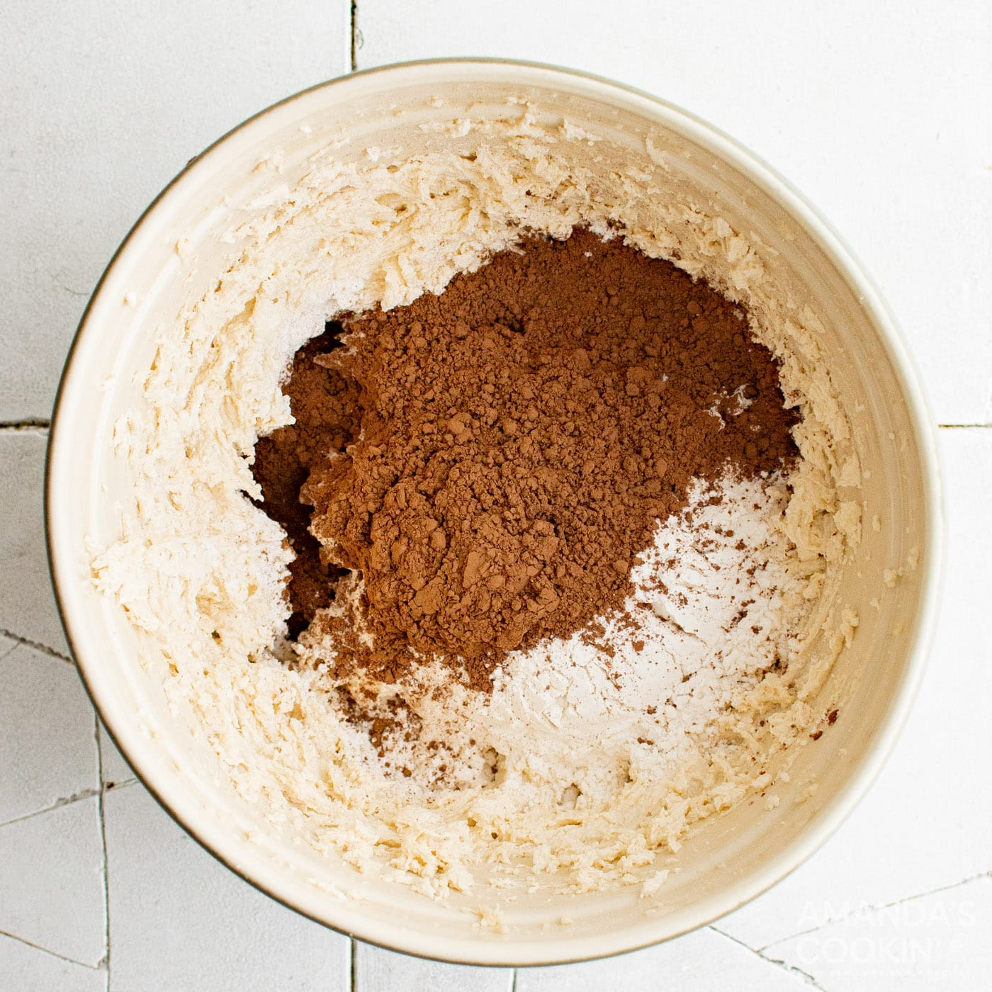 cocoa powder in a bowl of cookie dough