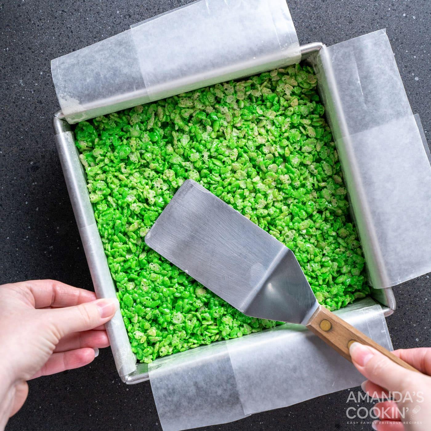 spatula patting flat rice krispie treats