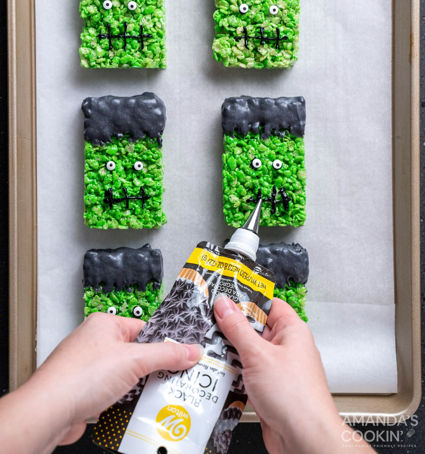 piping on frankenstein mouths to rice krispie treats