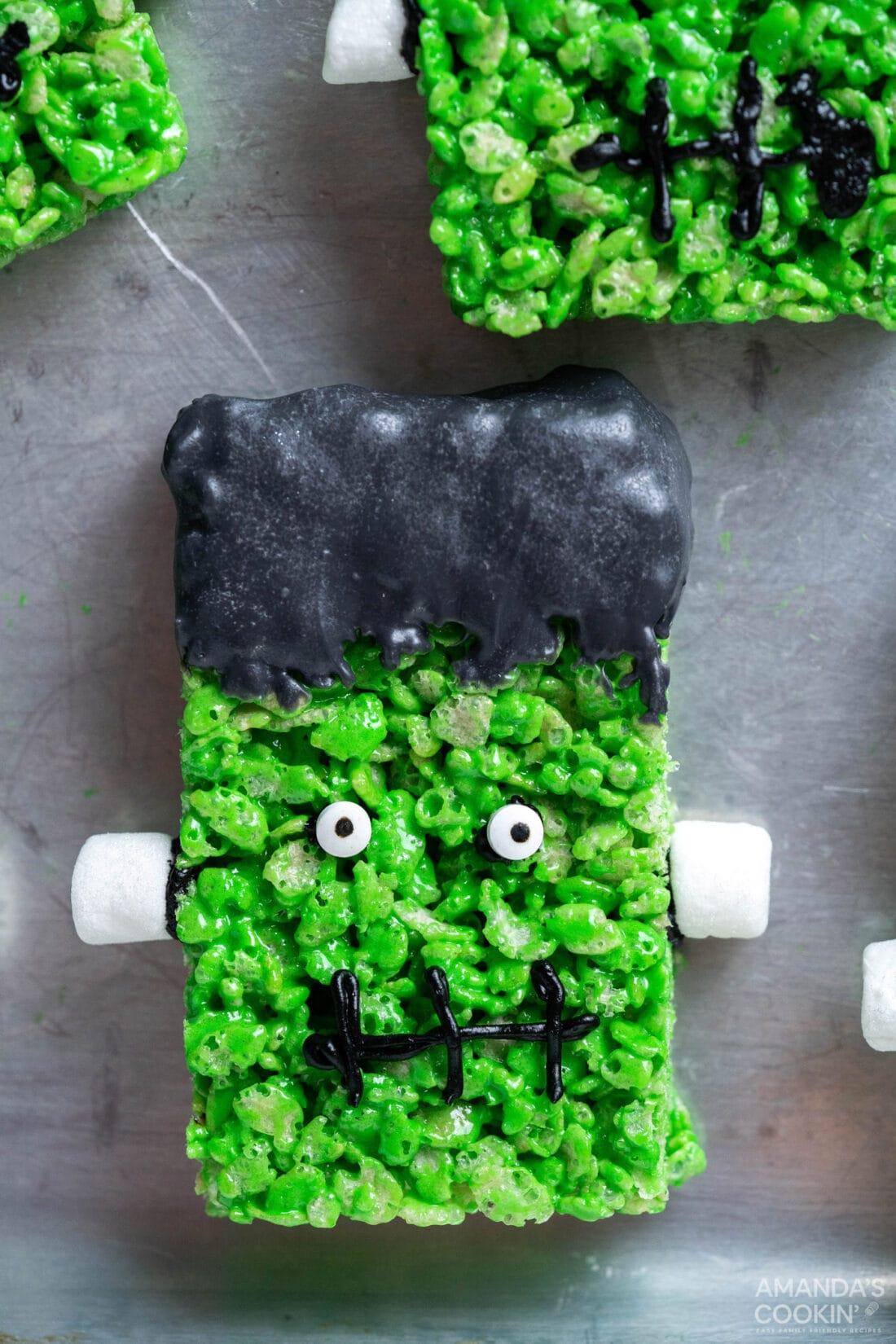Frankenstein Rice Krispie Treats on a cookie sheet