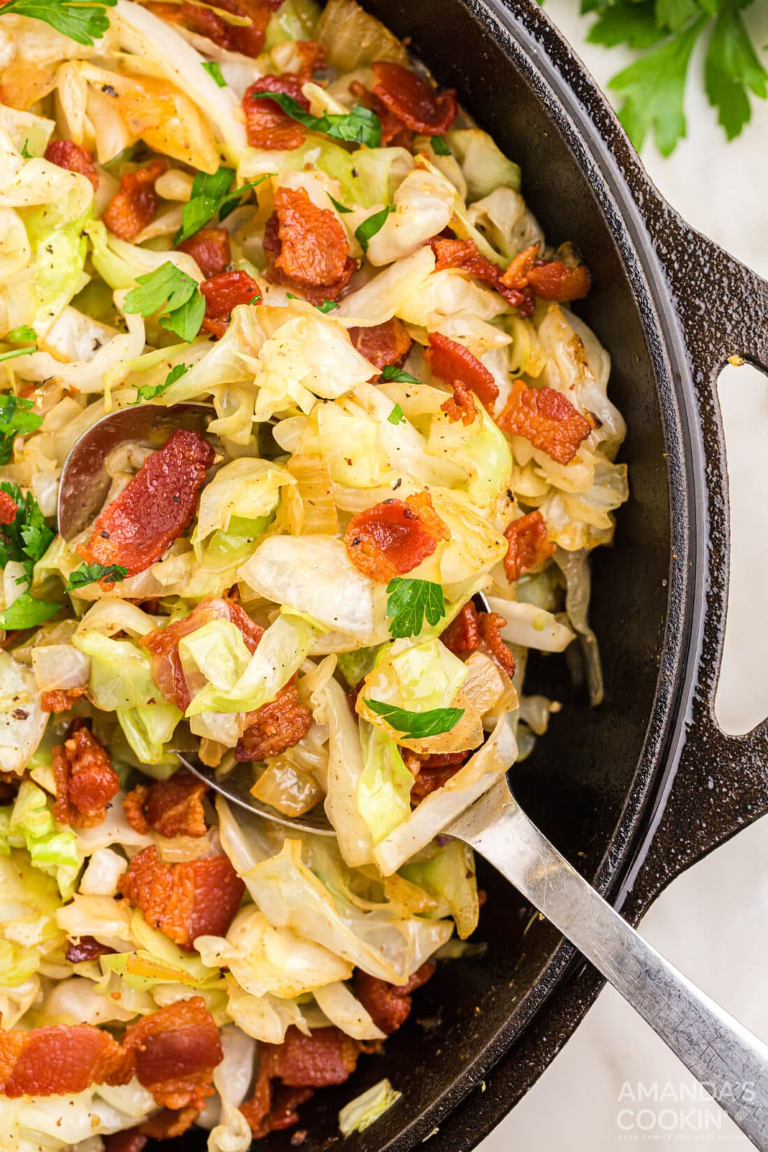 Fried Cabbage in pan with serving spoon