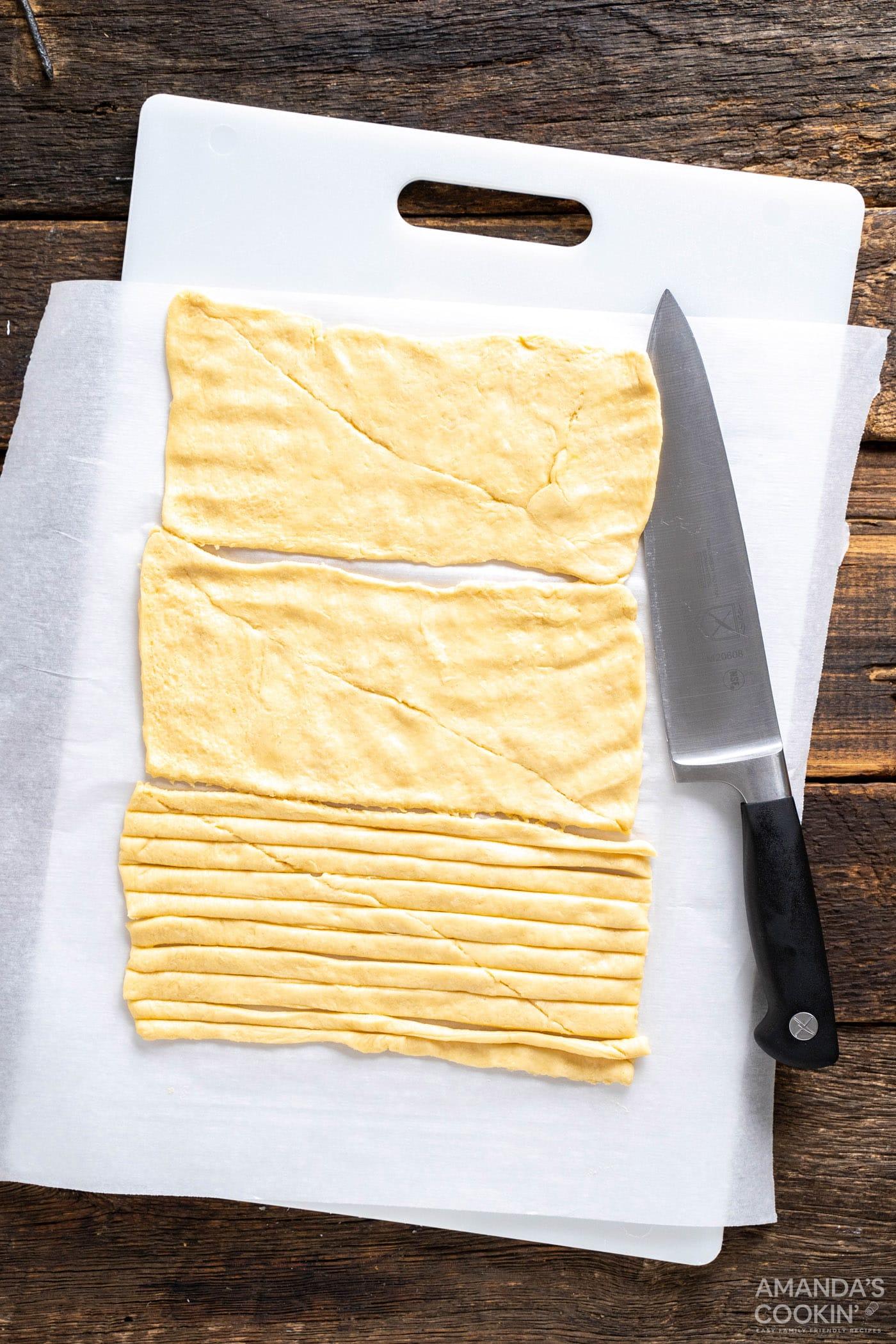 sliced crescent dough on a cutting board