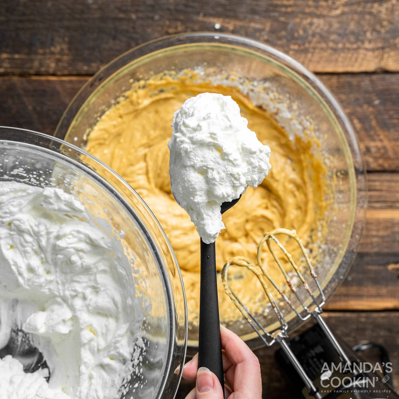 spoonful of whipped cream over cream cheese pumpkin mixture