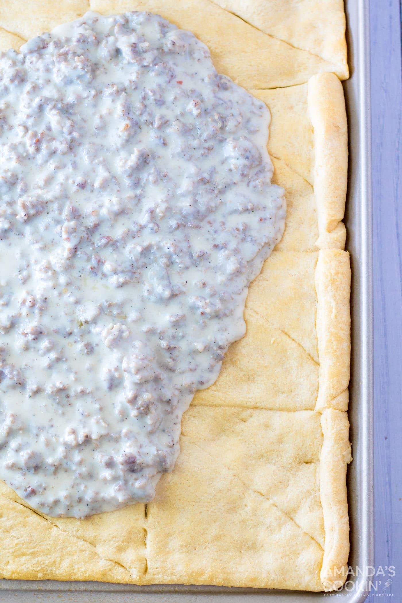 sausage gravy on top of crescent dough