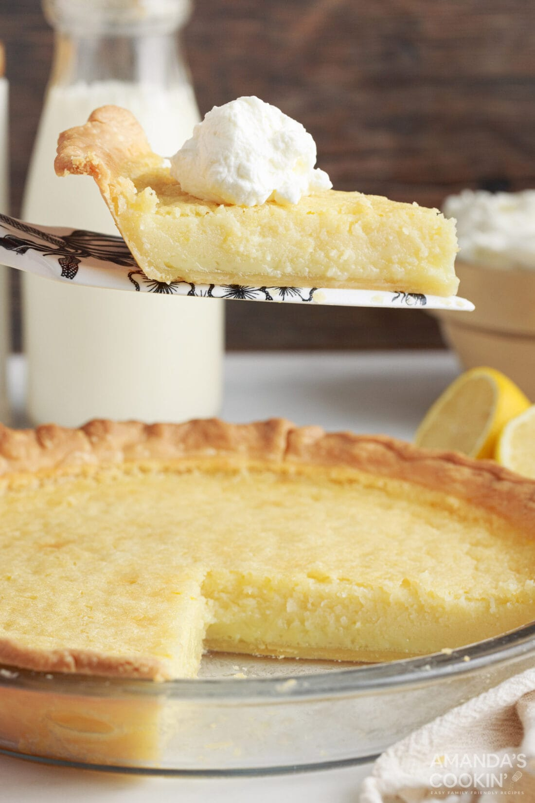 slice of Southern Buttermilk Pie being removed from pan