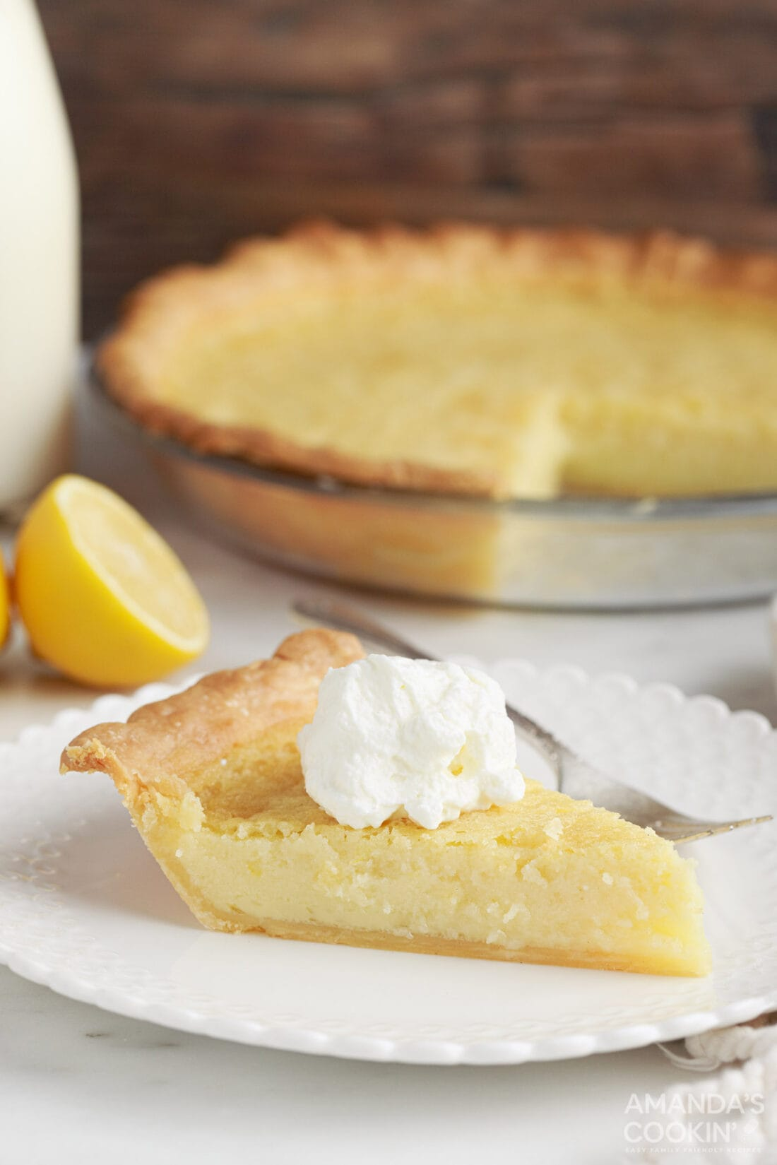 slice of Southern Buttermilk Pie with whipped cream