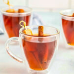 Spiked Caramel Apple Cider in glass mugs