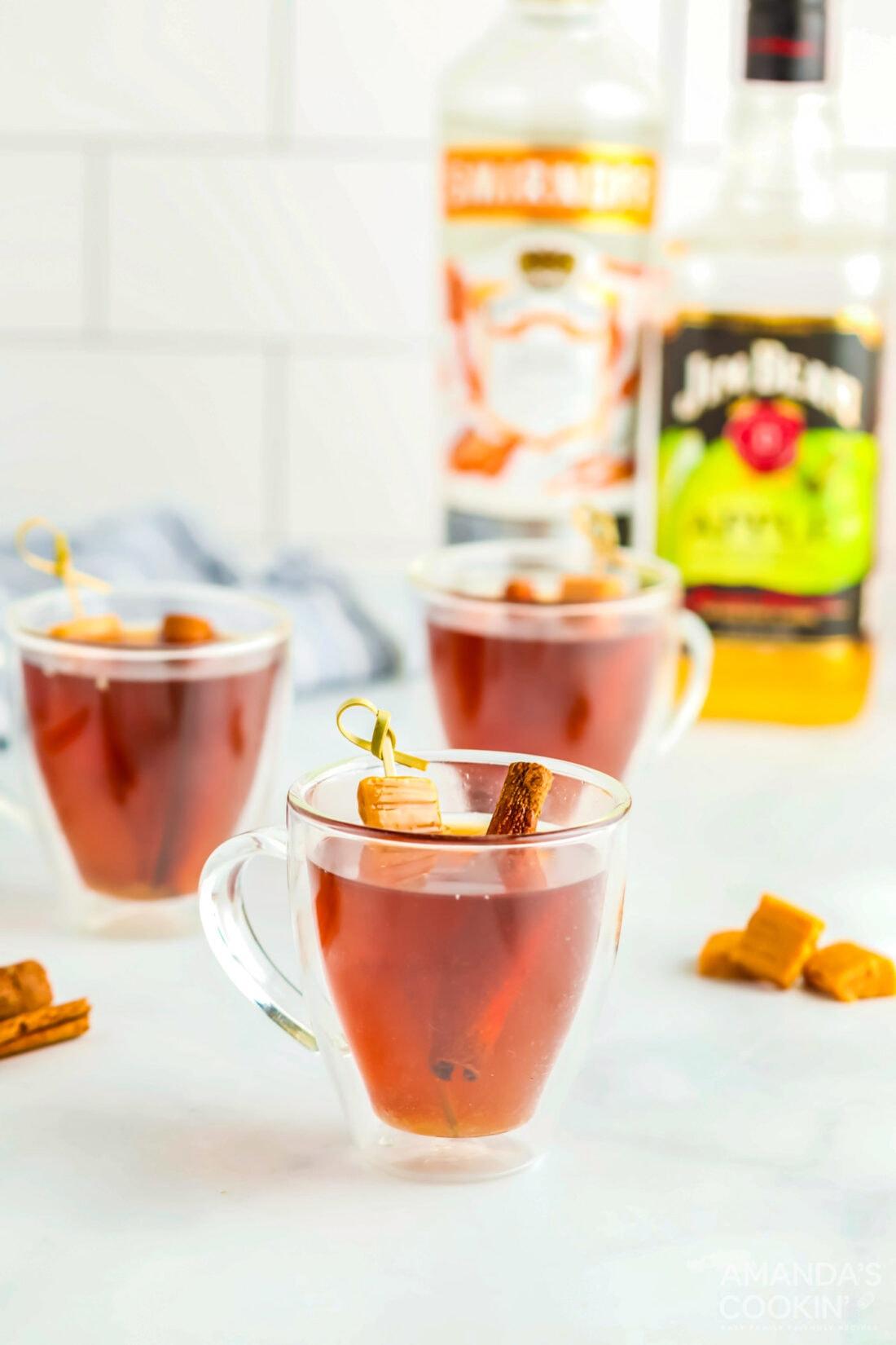 3 mugs of Spiked Caramel Apple Cider
