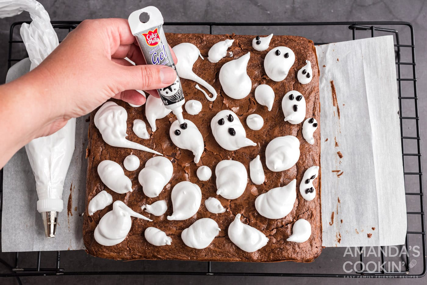 gel icing on marshmallow ghosts to make eyes and mouths