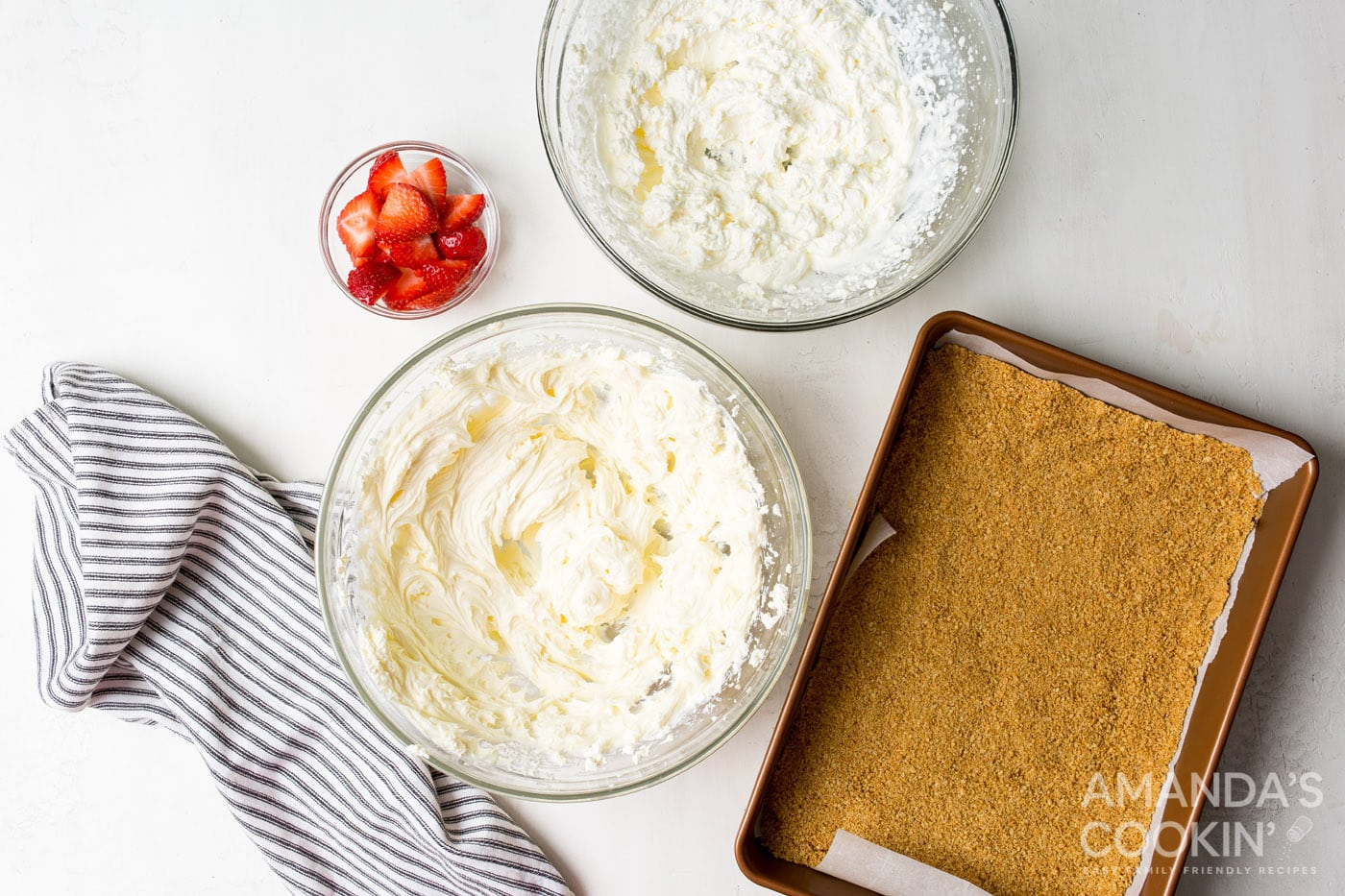 whipped cream and cheesecake mixture in bowls